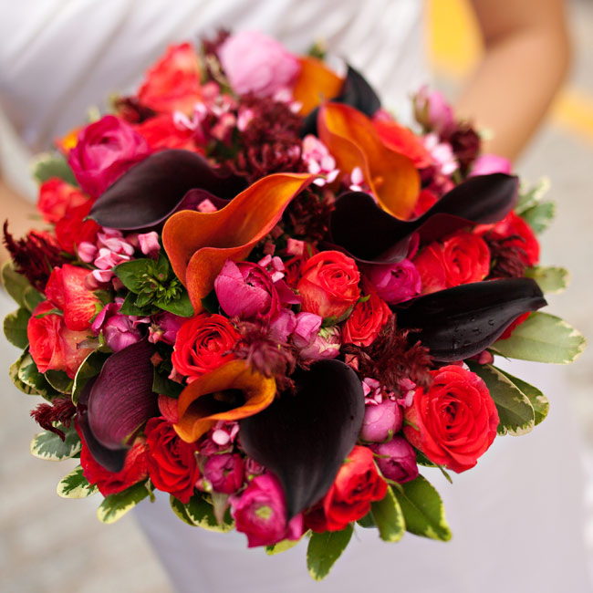 Cathy asked her florist for jewel tones and let him do the rest. Her lush bouquet included calla lilies, roses, feather celosia, and freesia.