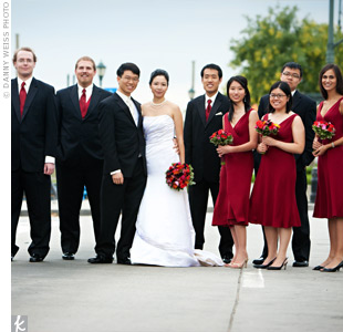 The guys&#39; burgundy ties and vests were a perfect match with the bridesmaids&#39; knee-length dresses (that they could really wear again!)