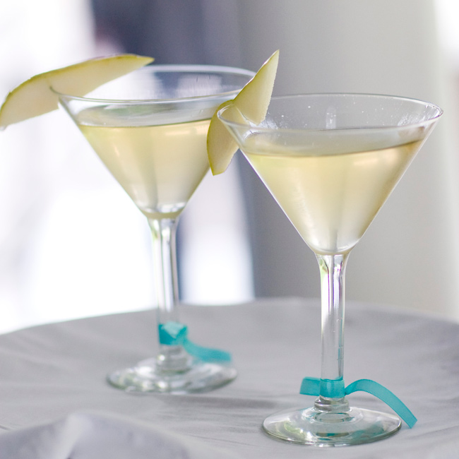 Because they matched the color scheme, the couple served their guests summery pear martinis. Blue ribbon finished them off.