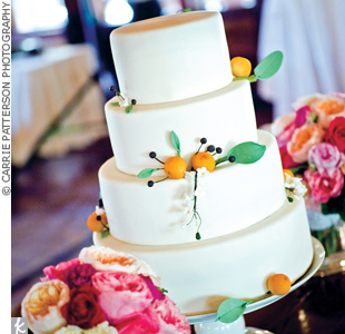 The four tiered cake was covered in fondant and decorated with sugar paste oranges, bay leaves, and huckleberries – highlighting the flavors hidden inside.