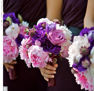 Like the bride's, the bridesmaids' bouquets contained peonies. To bring out the purple in their dresses, they also carried lisianthus, roses and scabiosas.