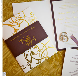 Inspired by the fleur-de-lis symbol of their engagement city, the invitations featured gold designs that echoed the old-world glamour of their wedding site.
