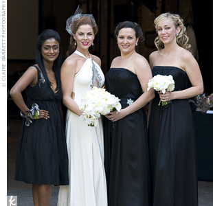 Angelas two matrons of honor wore matching black, strapless dresses that they could hem and wear again. Her other bridesmaid wore her own black dress.