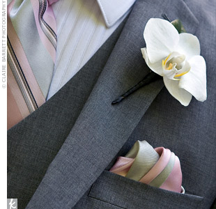 Michael wore a single white phalaenopsis orchid on his lapel to coordinate with Angelas bouquet.