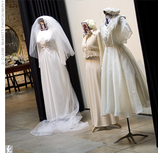Angela and Michael displayed their mothers' and Angela's grandmother's wedding dresses for guests to see as they arrived.