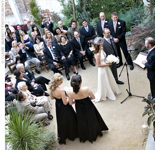 Angela and Michael exchanged vows outside on the back patio of Marvimon. A climbing wall garden made the perfect natural backdrop.