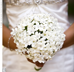 To keep with the modern circle theme, Lora carried a round bouquet of stephanotis studded with rhinestones and wrapped with an ivory ribbon.