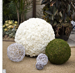 Various-sized moss and carnation pomanders decorated the outdoor space for the second ceremony at The Marvimon.