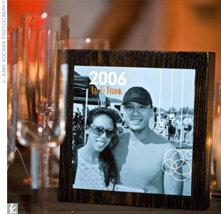 Each table was numbered after a year the couple had spent together before the wedding and accompanied by a picture of the couple during that year. The pictures were decoupaged onto wooden blocks.