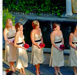 The simple yet elegant bridesmaid bouquets, which featured three bright red, oversized garden roses, popped against each maids gold satin Vera Wang cocktail dress.