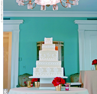 For a fashionable twist on their wedding cake, Emilys baker re-created the look of her veils lace trim in white frosting on top of gold-tinted icing. On the middle tier, the couples monogram gave it another personal touch. Even the flavors coordinated with the wedding colors, as chocolate and buttercake alternated with fresh raspberry filling.