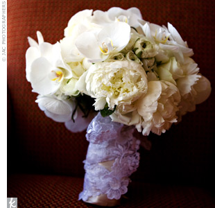 Two other Knotties' bouquets inspired Therese's all-white bouquet. She carried roses, ranunculus, and phalaenopsis orchids wrapped with lace left over from her mother's wedding gown.