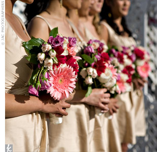 The bridesmaids carried pink and purple bouquets arranged to look like paper fans that popped against their neutral-colored dresses. Making the bouquets two-dimensional rather than three-dimensional saved money, so Therese could include all the flowers she wanted: spray roses, garden roses, and gerbera daisies.