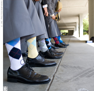 As gifts, Devin gave his groomsmen standout accessories like suspenders, straw fedora hats, and argyle socks for the wedding. Each guy's socks were a different color, which looked great in the pictures.