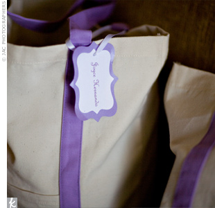 Therese gave her bridesmaids their gifts in cream and purple canvas totes -- practical because they could use the bags again. The bags were filled with sandals, rompers for getting ready the day of the wedding, earrings, and pashmina scarves.