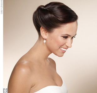 If you're looking for a bun with a bit more drama, consider swirling your hair back to highlight your stylish knot.    How to Get the Look: Step 1: Leave the entire crown area loose and tease to create volume. Step 2: Part the rest of your hair (the lower section) down the middle. Step 3: Twirl both side sections inward toward the back of you ...