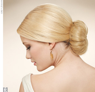 This classic bridal 'do looks chic with every neckline. Plus, you can wear any type of veil with this more structured style. 