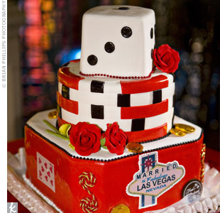 The dessert highlighted the setting in a big way, with a die as the top tier and playing cards and poker chip decorations. Although there were only 24 guests, the couple opted for a three-tiered cake for an even sweeter impact.