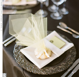 Antique-style chargers, tulle-wrapped favors (mini pound cakes!) and brown linens gave the tables a vintage vibe.