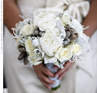 Melissa's wintry white bouquet set the romantic tone for the entire day. The lush arrangement included peonies, nerine lilies, roses, silver brunia and miniature pinecones.