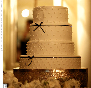 Swiss dots and slim ribbon accents dressed up the classic white cake.