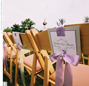 Each ceremony seat back had the couple's names on it. Scrollwork dressed them up and lavender ribbon worked in the signature hue.