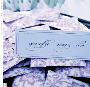 "Guests picked up pretty packets on their way into the ceremony. Each one contained lavender buds and eco-friendly confetti, so guests could shower the newlyweds after they said, ""I do."""