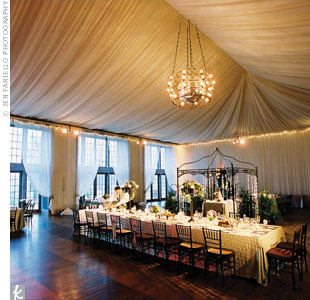 The event planner transformed the space with vaulted ceiling drapery and a wrought-iron chandelier. A gazebo matched the chandelier and gave the room a focal point.