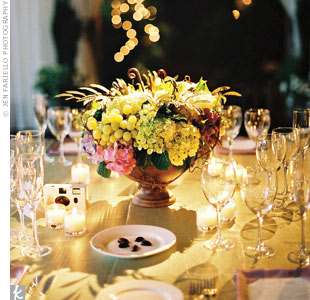 On the tables, rustic urns filled with grapevines, fiddlehead ferns, grapes, roses and hydrangeas had a Tuscan vibe.