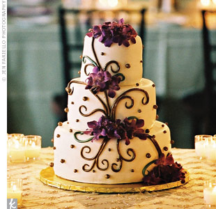 Echoing the feel of the gazebo that housed it, the romantic cake was decorated with chocolate swirls and different-sized dots. Bunches of fresh orchids added color.
