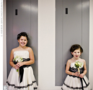 Julie's nieces, the flower girls, wore ivory dresses with black lace accents that coordinated with the bridesmaid dresses.