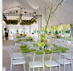 The tented reception felt more natural with greenery decorating the ceiling. A white-tiled dance floor kept the space looking airy and crisp.