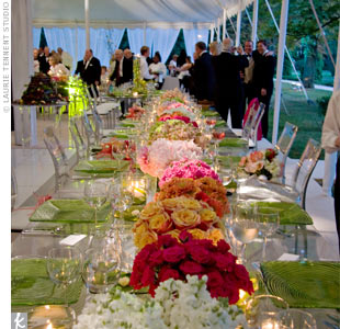 The long head table was decorated end-to-end with flowers, each arrangement of a different type: stock, roses, gerbera daisies, and peonies. They alternated between white, red, orange, and shades of pink.