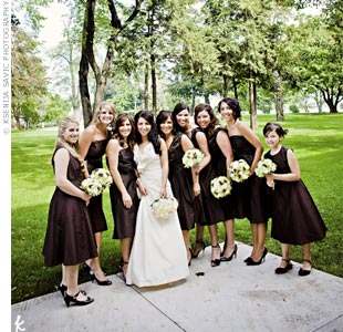 So that her bridesmaids would wear their dresses again, Linda let them choose between two brown taffeta Jim Hjelm dresses -- one was a strapless dress and the other a V-neck, A-line design.