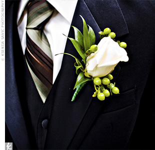 Michael and his groomsmen wore ivory rose boutonnieres accented with green berries.