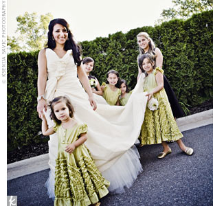 All of Linda and Michael's nieces were flower girls in their wedding. Linda searched all over the place for brown dresses, but couldn't find anything she liked. When her sister found adorable dresses that perfectly matched the wedding's green accent color, Linda had to have them.