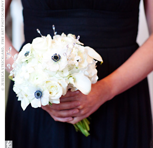 To create contrast against their black dresses, the bridesmaids carried white bouquets of roses, lilies, hydrangeas, and anemones. Crystal accents added a bit of sparkle to the arrangements.