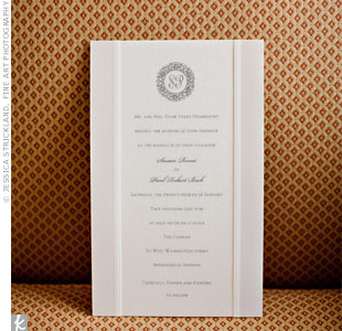 The invitations, printed on high-gloss white paper with a shimmering fabric overlay, set the tone for the rest of the winter white wedding details.