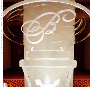 A monogrammed ice sculpture created an impressive backdrop for the escort cards.
