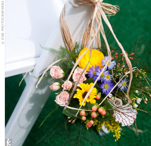 The couple didn't add much to the beautiful lawn where the ceremony took place, just Mason jars filled with wildflowers tied to the chair at the end of each row.