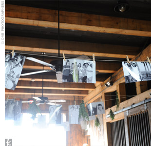 Herbs, dried flowers, and black-and-white photos of the couple and their families from their childhood hung from clothespins adding a really personal touch.
