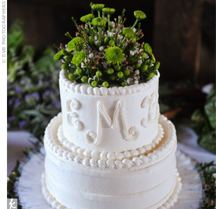 Because the catered menu included a delicious dessert, Emily and Brian just bought a small, two-tiered wedding cake from Publix supermarket! They added their monogram to the top tier and dressed it up with wildflowers.