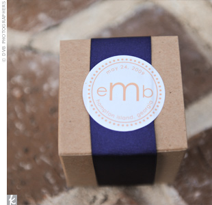 In order to incorporate their locale into their favors, Emily and Brian ordered small jars of Savannah Bee Company honey, boxed them, and added labels from Wedding-Ideas-and-Details.com.