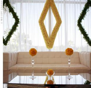 The designers played on the baseball theme with ball- and diamond-shaped floral decor.