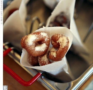 Hot, fresh mini doughnuts were dusted with powdered sugar and served up in paper cones.
