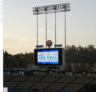 Throughout the evening, The Knot and participating vendors had their logos displayed on the stadium's Jumbotron.