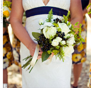 Tara carried a bouquet of white garden roses accented with navy verbena buds, which looked a lot like blueberries!