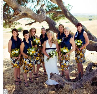 Instead of dresses, the bridesmaids partnered skirts with solid navy tops from J.Crew. To accessorize, Tara bought each girl a yellow wooden ring, engraved with either a peace sign or a heart.