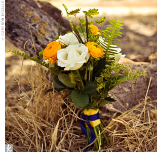 Tara's bridesmaids carried petite, earthy bouquets of yellow ranunculus and white garden roses accented with ferns.