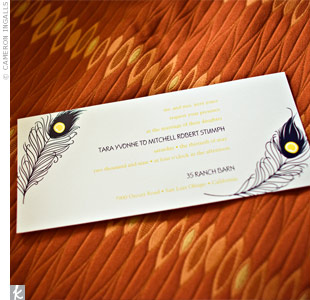 Tara and Mitch incorporated their wedding colors, navy and marigold, as well as peacock feathers (which became another recurring wedding detail), into their invitations.